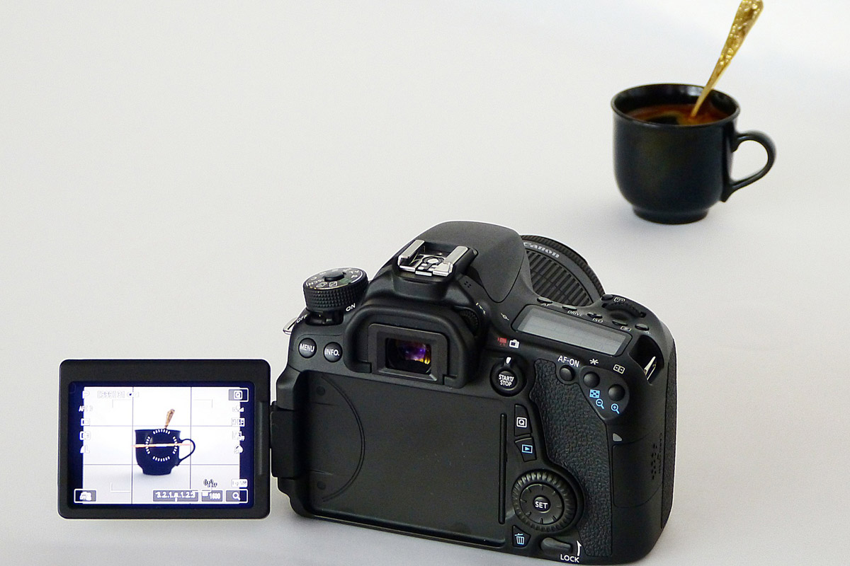 Camera capturing black coffee cup